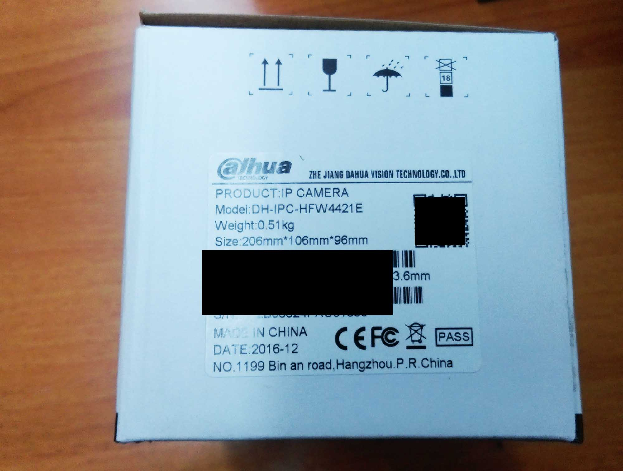 The label on the box. DH means the camera has Dahua logo inscriptio.